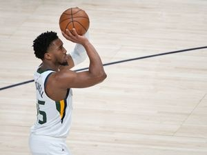 (Francisco Kjolseth  | The Salt Lake Tribune) Utah Jazz guard Donovan Mitchell (45) at the line as the Utah Jazz take on the Milwaukee Bucks at Vivint Smart Home Arena in Salt Lake City, on Friday, Feb. 12, 2021.