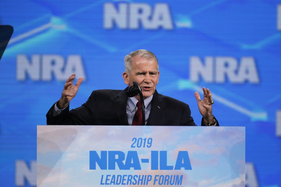 In this Friday, April 26, 2019 photo, National Rifle Association President Col. Oliver North speaks at the National Rifle Association Institute for Legislative Action Leadership Forum in Lucas Oil Stadium in Indianapolis. On Saturday, North announced that he will not serve a second term as the president of the NRA amid inner turmoil in the gun-rights group. (AP Photo/Michael Conroy)