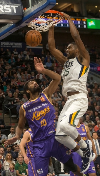 (Rick Egan | The Salt Lake Tribune) Utah Jazz forward Derrick Favors (15) dunks the ball over Sydney Kings center, Amritpal Singh, (10), in preseason basketball Utah Jazz vs.Sydney Kings, in Salt Lake City, Sunday, October 2, 2017.