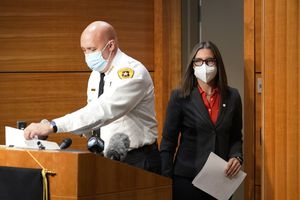 """(AP Photo/Rick Bowmer) Salt Lake City Mayor Erin Mendenhall and Chief of Police Mike Brown arrive for a news conference held at the Public Safety Building Monday, Sept. 21, 2020, regarding a police shooting of a teenage boy. In another news conference later that month, Mendenhall promised transparency after a review of the city's K-9 apprehension unit uncovered a """"pattern of abuse of power."""""""