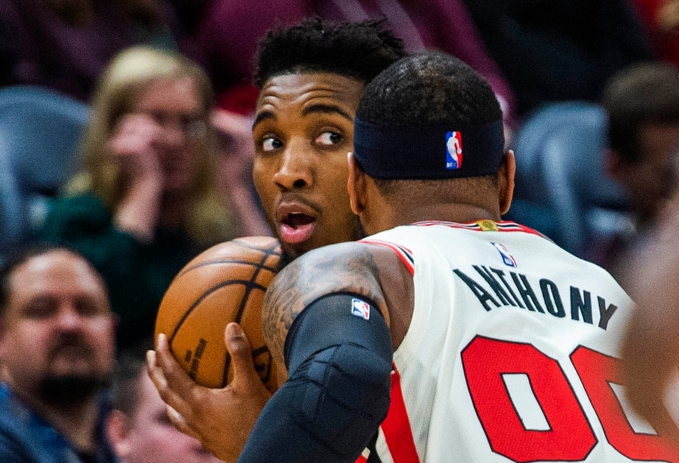 (Rick Egan | The Salt Lake Tribune) Portland Trail Blazers forward Carmelo Anthony (00) guards Utah Jazz guard Donovan Mitchell (45), in NBA action between the Utah Jazz and the Portland Trail Blazers in Salt Lake City, Friday, Feb. 7, 2020.