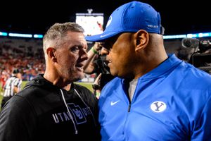 (Trent Nelson  |  The Salt Lake Tribune)  Coaches Kyle Whittingham and Kalani Sitake shake hands after the game as Brigham Young University (BYU) hosts the University of Utah, NCAA football in Provo on Friday Aug. 30, 2019.
