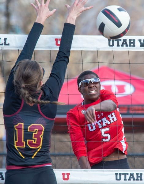 (Rick Egan | The Salt Lake Tribune) Keana Smalls hits the ball for Utah, as Magdalena Dabrowski defends for CMU, in beach volleyball action between Utah and Colorado Mesa, in the first home tournament in history for the University of Utah, Saturday, April 13, 2019.