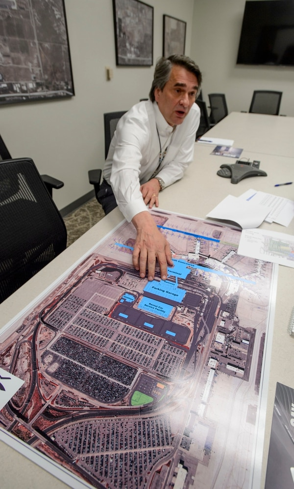 (Steve Griffin   The Salt Lake Tribune) John Buckner, director of administration and commercial services for the Salt Lake City Department of Airports, uses a map to show how the new airport will look.
