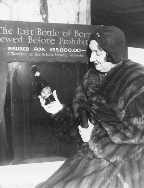 FILE - In this Dec. 29, 1930, file photo Rae Samuels holds the last bottle of beer that was distilled before prohibition went into effect in Chicago. The bottle of Schlitz has been insured for $25,000. (AP Photo, File)