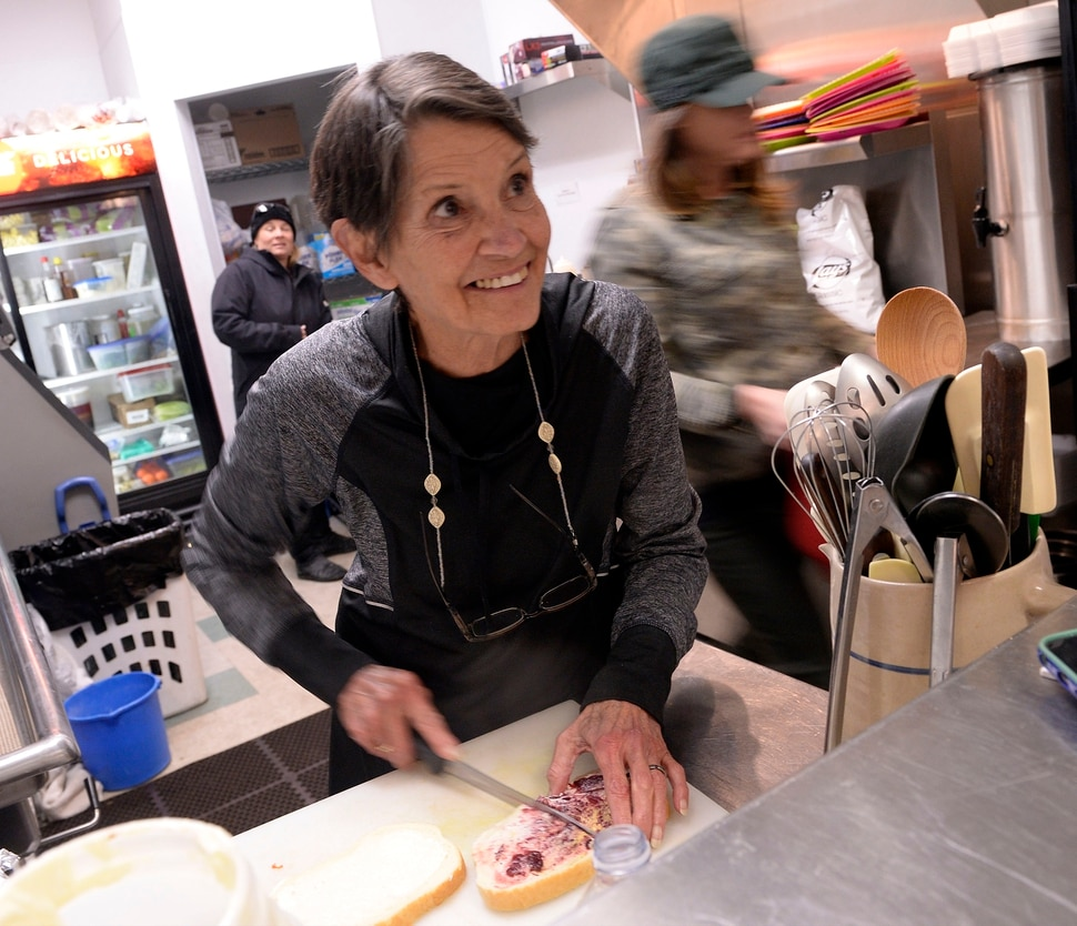(Al Hartmann | The Salt Lake Tribune) Karleen Reilly looks up from making a sandwich to greet a friend at Uptown Fare in Park City. She has been the tell-it-like-it-is owner of Uptown Fare in Park City for nearly two decades. Originally, her sandwich shop was in an underground building on Main Street. But it moved to a new location — attached to the Kimball Arts Center — a few years ago. She has announced her retirement on March 1, so this will be her last Sundance Film Festival.