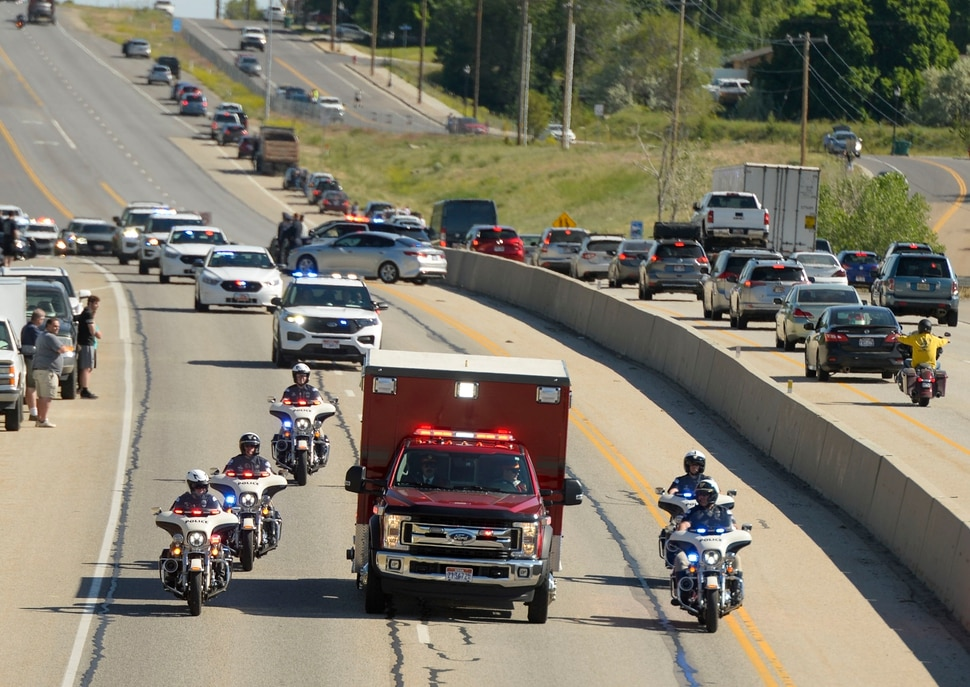 (Leah Hogsten | The Salt Lake Tribune) Ogden City Police Department leds the procession for fallen Ogden City Police Officer Nate Lyday, whose body was transported from the Medical ExaminerÕs office in West Valley City to a mortuary in Ogden on Friday. Officer Lyday died in a shooting after responding to a domestic violence call May 28, 2020 in Ogden. A suspect was killed and an officer with Adult Probation and Parole was injured at the scene.