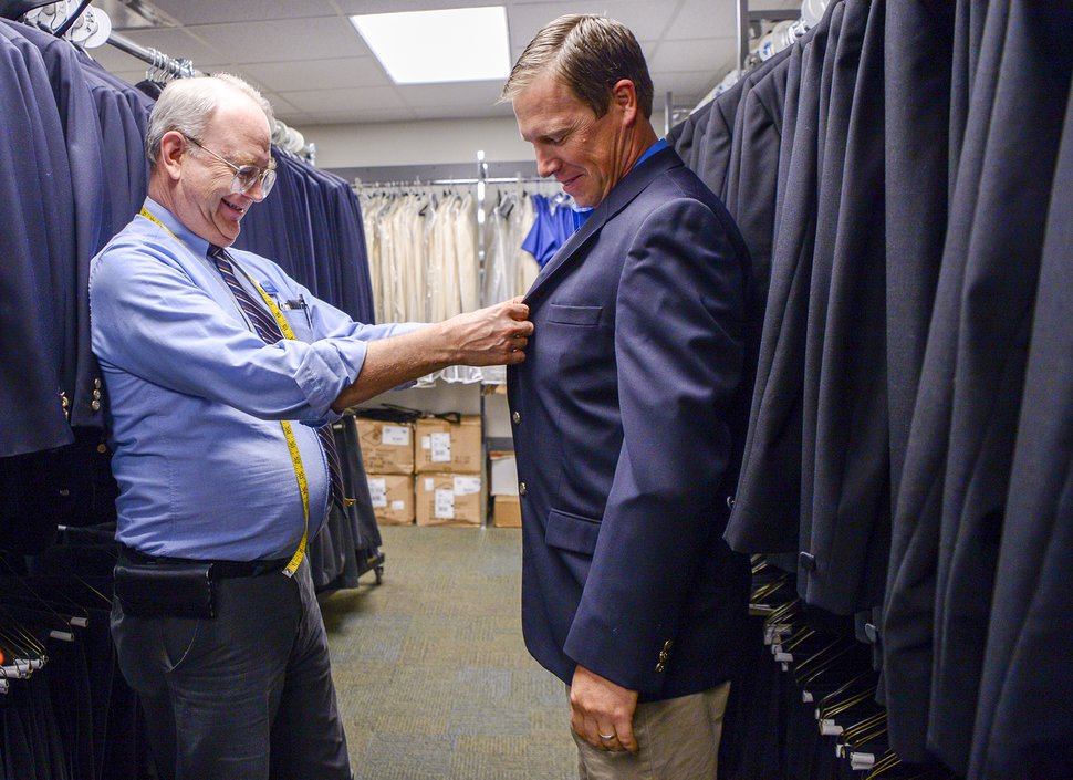 Leah Hogsten | The Salt Lake Tribune Vance Everett, left, the Tabernacle Choir's wardrobe chairman, fits Daniel Wilson into the sport coat he will wear Sunday, when he sings with the Tabernacle Choir.