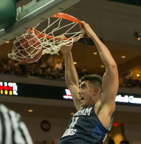 Rick Egan | The Salt Lake Tribune Brigham Young center Corbin Kaufusi (44) dunks the ball for the Cougars, in the West Coast Conference Semifinals, at the Orleans Arena in Las Vegas, Saturday, March 7, 2016.