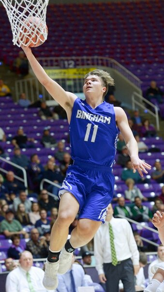 (Leah Hogsten | The Salt Lake Tribune) Bingham's Dalton Miller (11) aims for the net on a fast break steal. Miller had 5 points and 3 rebounds in the first half. Copper Hills faces Bingham in the 6A High School Boys' Basketball Tournament opening game at Weber State University's Dee Events Center in Ogden, Tuesday, Feb. 27, 2018.