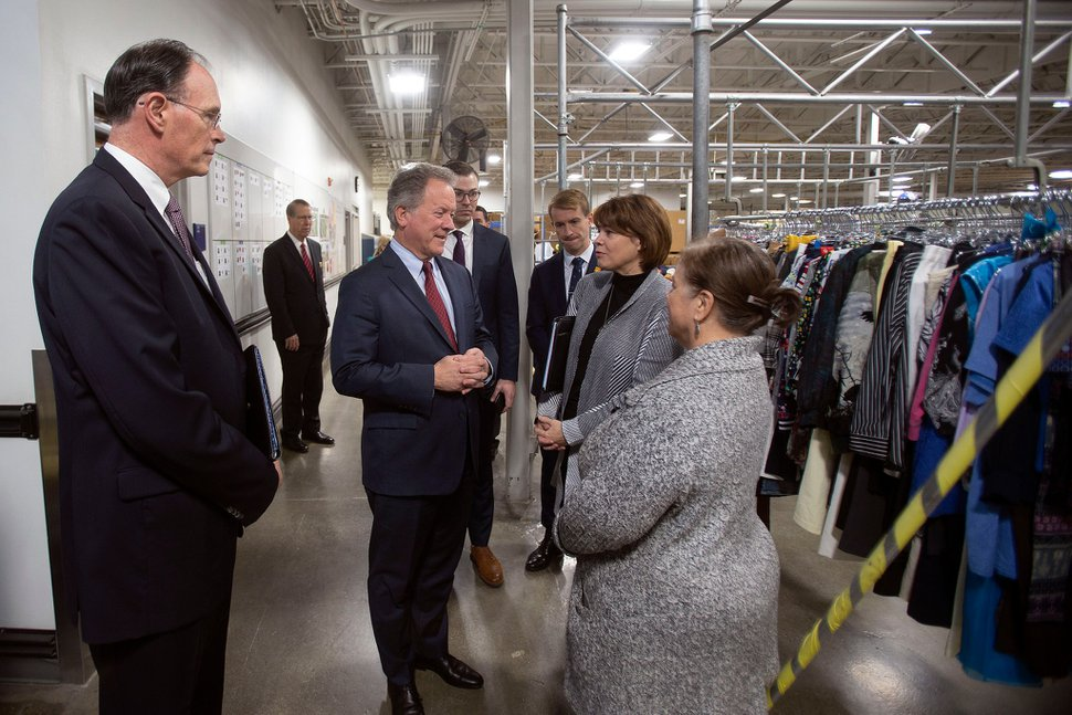 (Photo courtesy of The Church of Jesus Christ of Latter-day Saints) The tour of the bishops' storehouse at Welfare Square in Salt Lake City includes showing how the church cleans donated clothes for purchase at the local Deseret Industries. Bishop W. Christopher Waddell, left, of the Presiding Bishopric is with David Beasley, center, executive director of the United Nations World Food Programme, and Sharon Eubank, center left, head of Latter-day Saints Charities, on Monday, Sept. 30, 2019.