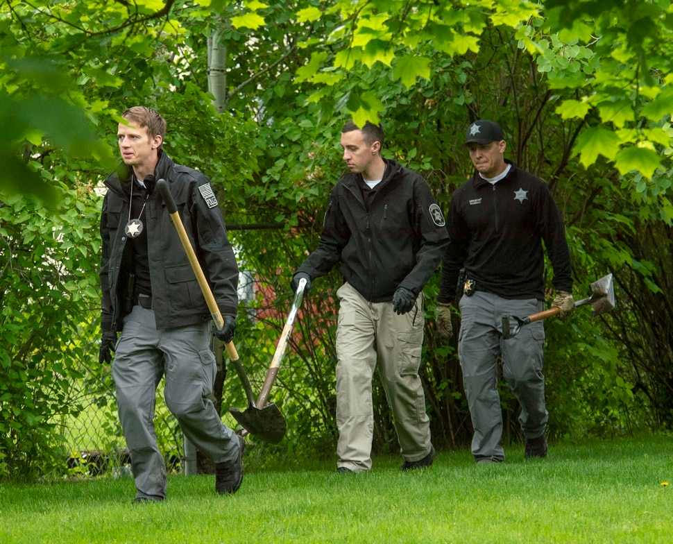 (Rick Egan | The Salt Lake Tribune) A group of local police and search & rescue crews search the property of nearby homes as they look for 5-year-old Elizabeth Shelley, in Logan. Tuesday May 28, 2019