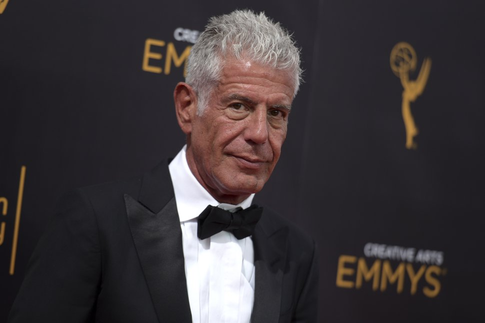 FILE - In this Sept. 11, 2016 file photo, Anthony Bourdain arrives at night two of the Creative Arts Emmy Awards at the Microsoft Theater in Los Angeles. Court papers show globetrotting chef, author and TV host Bourdain was worth $1.2 million when he died last month. Most of his estate was left to his 11-year-old daughter. (Photo by Richard Shotwell/Invision/AP, File)