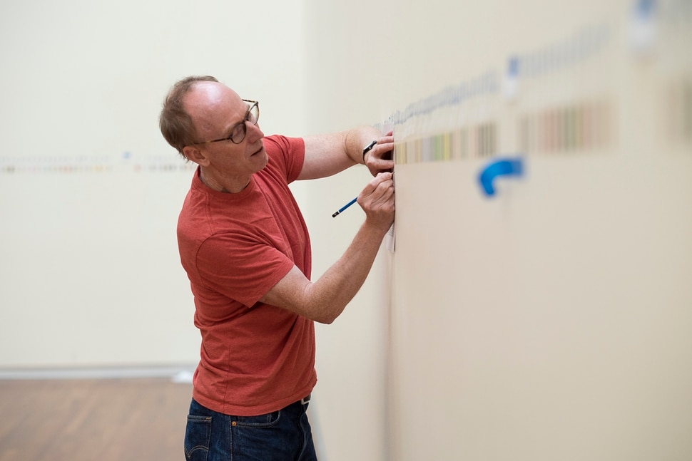 (Courtesy Utah Museum of Fine Arts) Spencer Finch works on his installation exhibit in the Great Hall of the Utah Museum of Fine Arts. The installation, based on the colors Finch found on a trip around the Great Salt Lake, will open along with the museum on Aug. 26, 2017.