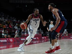 (Charlie Neibergall | AP) United States' Kevin Durant (7) drives around France's Rudy Gobert (27) during men's basketball gold medal game at the 2020 Summer Olympics, Saturday, Aug. 7, 2021, in Saitama, Japan.