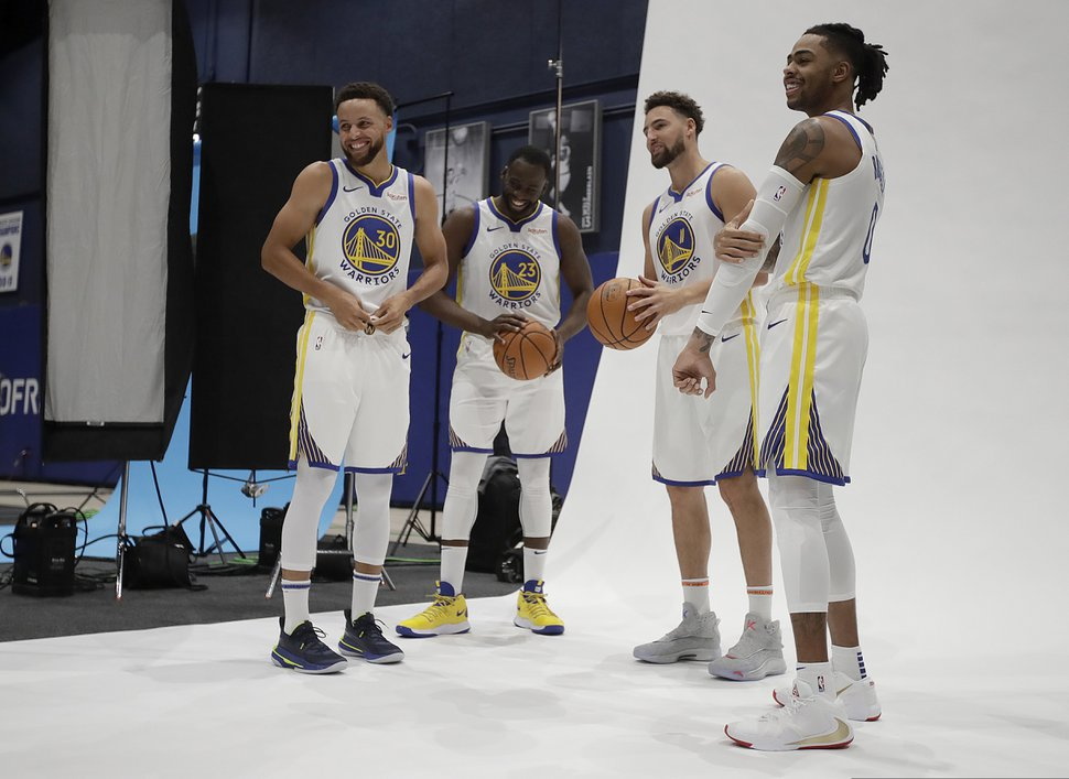 From left to right, Golden State Warriors' Stephen Curry, Draymond Green, Klay Thompson and D'Angelo Russell prepare for a photo shoot during the NBA basketball team's media day in San Francisco Monday, Sept. 30, 2019. (AP Photo/Ben Margot)