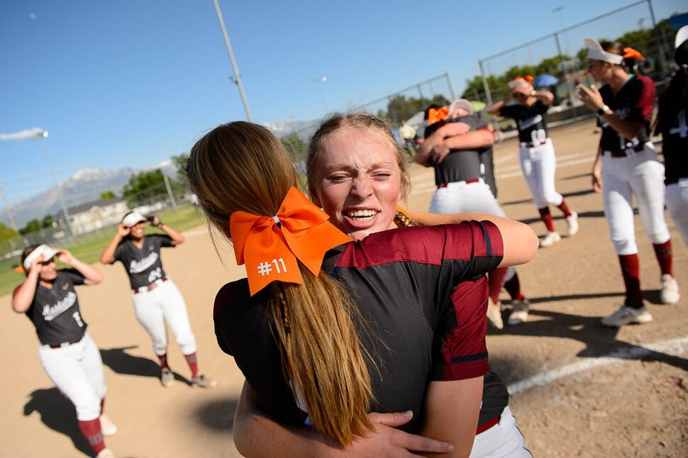 (Trent Nelson | The Salt Lake Tribune) Herriman players celebrate a win over Syracuse in the 6A Softball State Championship game, Thursday May 24, 2018. Herriman's Kiley Avery (8) and Herriman's Kaitlyn Slade (10) embrace.