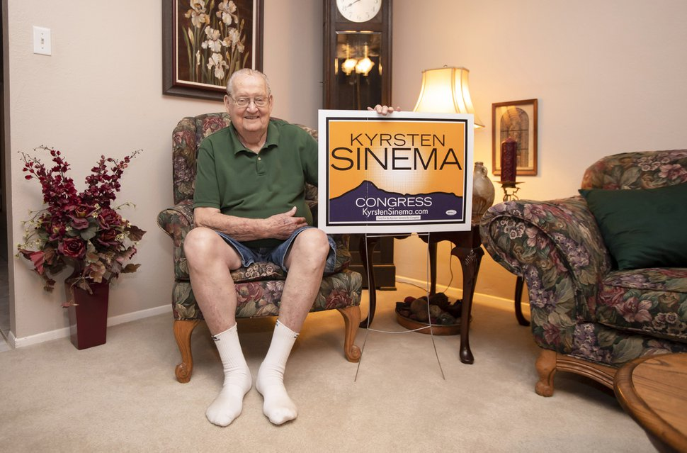 (Photo for The Washington Post by Billy Hardiman) Gerald Sinema, grandfather of Rep. Kyrsten Sinema, holds a campaign sign at his home in Phoenix, Arizona on August 23, 2018.