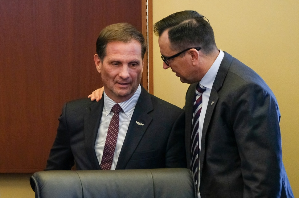 (Francisco Kjolseth   The Salt Lake Tribune) Congressman Chris Stewart, left, speaks with House speaker Greg Hughes following comments in the majority caucus meeting by the congressman on day two of the 2018 legislative session on Tuesday, Jan. 23, 2018.