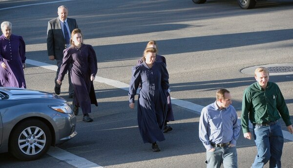 Al Hartmann | The Salt Lake Tribune Members of the FLDS Church walk to Federal Court in Salt Lake City Tuesday Oct. 3 for a two-day hearing to hear testimony from FLDS members and government witnesses to determine whether defendants have a religious right to share their food stamp benefits.