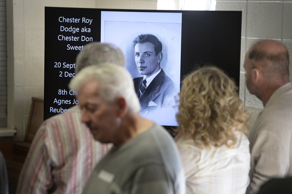 (Scott Sommerdorf | The Salt Lake Tribune) An old family photo of Chester Roy Dodge aka Chester Don Sweet is displayed as part of a slide show playing as newly connected families gathered for a reunion, Thursday, November 9, 2017 at the Bountiful Tabernacle.