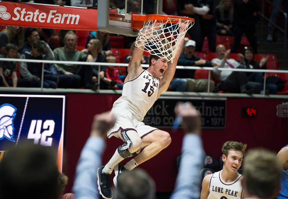 Scott Sommerdorf | The Salt Lake Tribune Lone Peak's Jackson Pollard yells as he dunks late in the second half as Lone Peak beat Layton 82-47, in a boy's 6A semi-final, FrIday, March. 2, 2018.