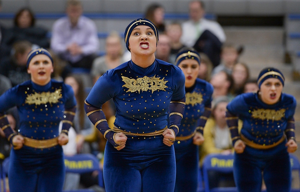 (Leah Hogsten | The Salt Lake Tribune) Brook Edwards and her fellow team members of the Spinnakers drill team, famous for using sabres in its routines, is celebrating its 50th season, performing in front of Cyprus High School boosters. Cyprus High School has grown and changed since the gym and what may be the state's oldest operating indoor pool were constructed in 1955. A new school is in the works, badly needed to accommodate a growing population on the west side's close-knit community, where long-time fans show up no matter how good or bad the Pirates are.