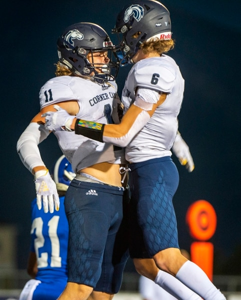 (Rick Egan | The Salt Lake Tribune) Corner Canyon receiver Jett Meine (11) celebrates his touchdown catch with Talmage Handley in prep action between the Bingham Miners and the Corner Canyon Chargers, at Bingham High on Friday, Aug. 28, 2020.