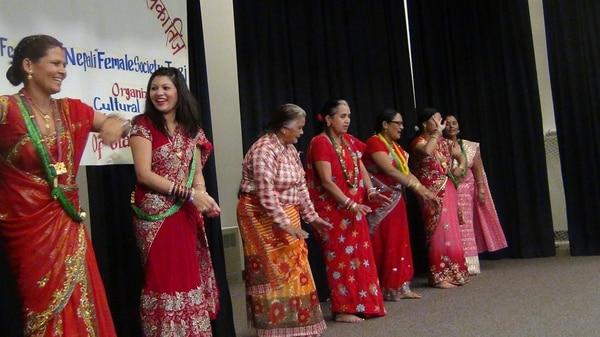 (Photo courtesy of Gyanu Dulal) Bhutanese/Nepalese women dancing at their 2016 annual festival at the Krishna temple in Salt Lake City