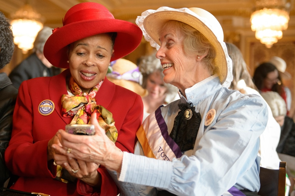 (Trent Nelson | The Salt Lake Tribune) Dr Jackie Thompson and Marilyn Barton share a moment in the Gold Room at the state Capitol in Salt Lake City before a celebration of suffrage on Wednesday, Feb. 12, 2020.