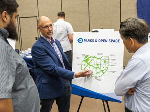(Rick Egan | The Salt Lake Tribune) Jim McRae talks to concerned citizens Thursday about plans for The Point, a development project that will be built on the prison site in Draper.