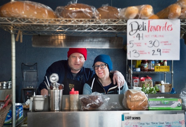 (Scott Sommerdorf | The Salt Lake Tribune) Owners Colter Wade and Meg Palmer pose for a photo inside The Back Door Deli, 136 Heber Ave. (corner of Heber and Swede Alley), where they are known for some of the best deli sandwiches in Park City.