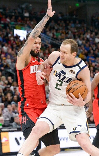 (Leah Hogsten   The Salt Lake Tribune) Utah Jazz guard Joe Ingles (2) battles Houston Rockets guard Austin Rivers (25) to get to the net. The Utah Jazz host the Houston Rockets at Vivint Arena, Feb. 22, 2020.