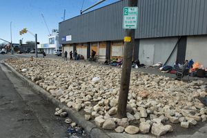 (Rick Egan | The Salt Lake Tribune) The grass park strip, where unsheltered people used to pitch their tents, has been replaced by giant rocks on the corner of 700 South and State Street, on Tuesday, Feb. 23, 2021.