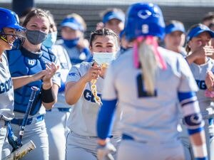 (BYU Photo) Senior Rylee Jensen (2) makes it back home after hitting a home run during the second game of the recent Dixie State series. Jensen led off Thursday's game against Virginia Tech in the NCAA Regional with a home run.