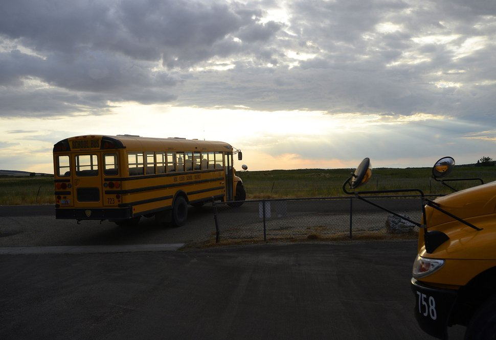 (Al Hartmann   The Salt Lake Tribune) Two school buses ferry students to and from Park Valley School, for first bell at 7:40 a.m. on Wednesday, Aug 30, 2017. Having a new four-day school week made for long days that first week of school.