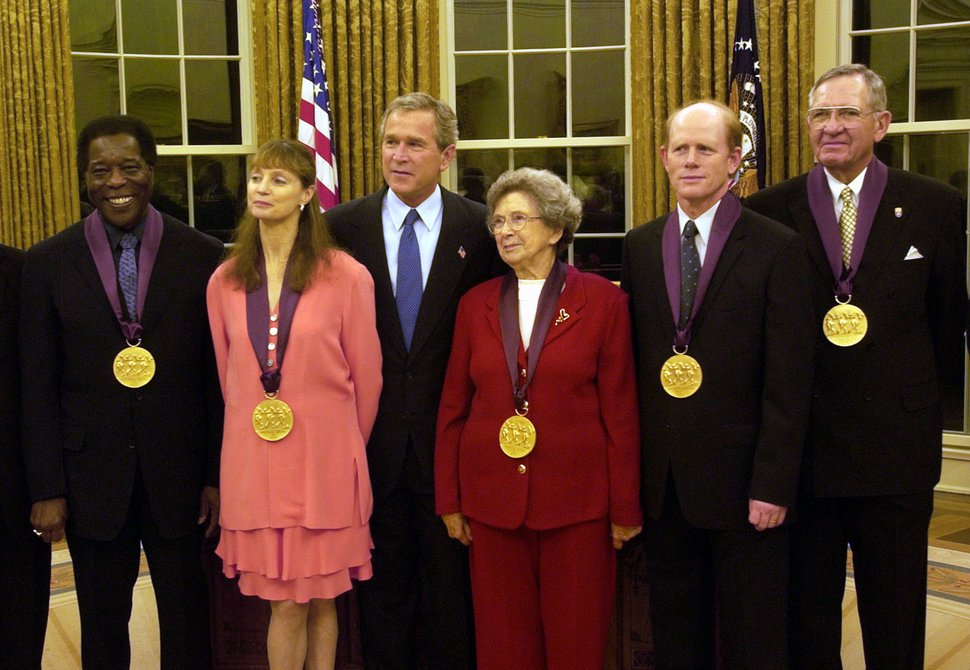 (Gerald Herbert | AP file photo) President George W. Bush poses with National Medal of the Arts recipients during a ceremony in the Oval Office at the White House in Washington, Wednesday, Nov. 12, 2003. Mac Christensen, president of the Mormon Tabernacle Choir, is at far right.