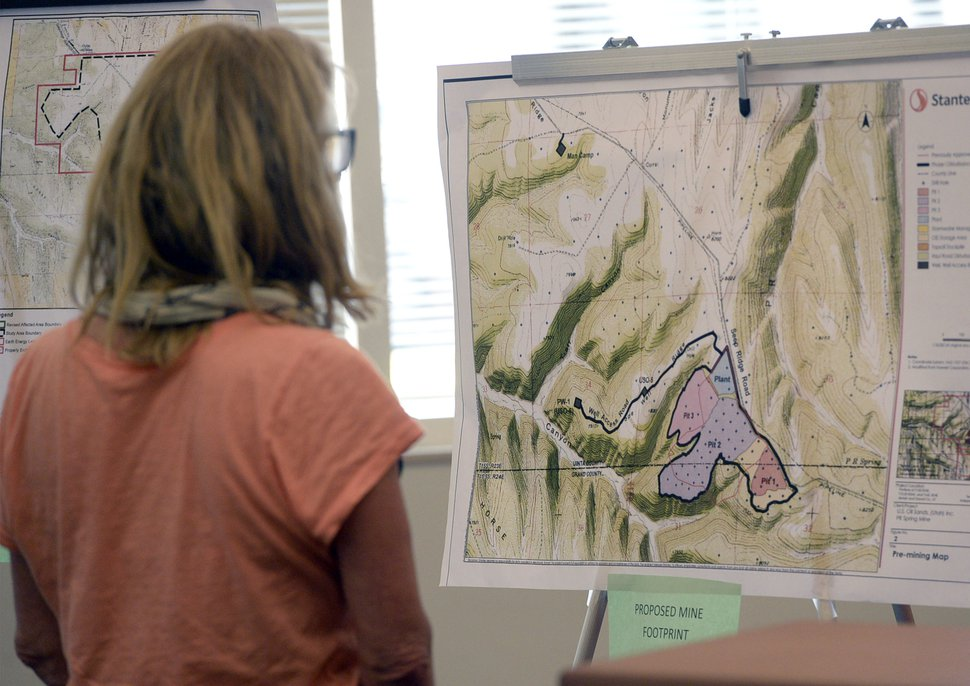 Al Hartmann | The Salt Lake Tribune Citizen looks at map with proposed tar sands mine footprint on the Uintah- Grand County line at a crucial hearing at the Utah Board of Oil, Gas and Mining Tuesday June 30 at the Utah Dept. of Natural Rescources building in Salt Lake City.