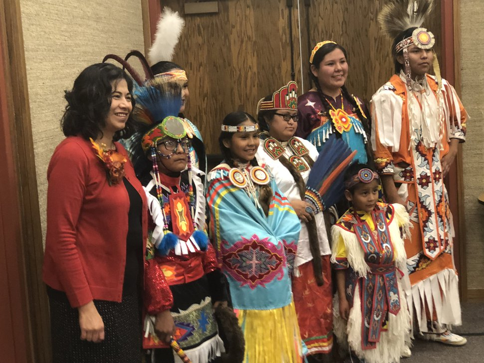 (Courtesy photo | The Church of Jesus Christ of Latter-day Saints) Navajo children take a picture with Reyna I. Aburto, second counselor in the Relief Society general presidency, in Chinle, Ariz., Nov. 9, 2018. The children dressed in regalia to dance for the Latter-day Saint leader.