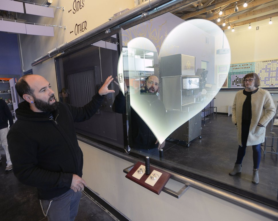 (Al Hartmann | The Salt Lake Tribune) David Heiblim, owner of The Dispensary, shows one of the interactive games at the soon-to-open Salt Lake City restaurant.