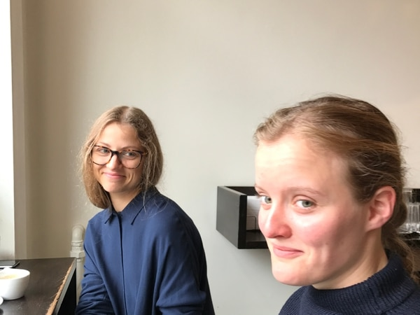 (Heather May | For the Tribune) Veronica, 28, left, and Thordis, 25, in a cafe in Bergen where it rains more than 230 days a year. They donÕt complain about the rain and instead embrace it as a part of nature. Happy people, according to research, appreciate what they have.