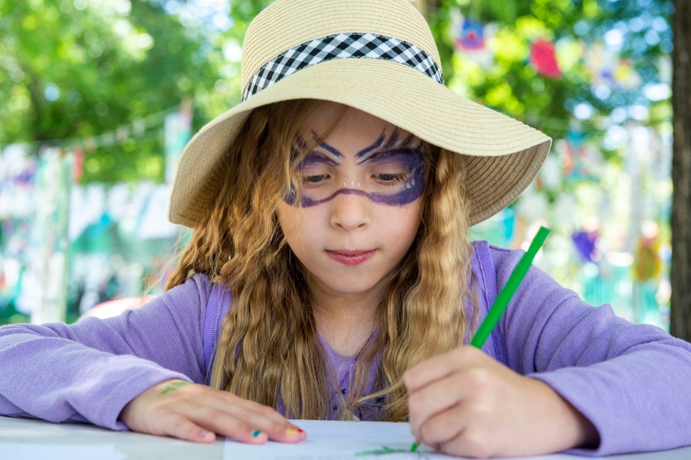 (Rick Egan | The Salt Lake Tribune) Jane Jane Virost, from Kaysville, works a a butterfly drawing in the Art Yard, at the Utah Arts Festival, Saturday, June 22, 2019.
