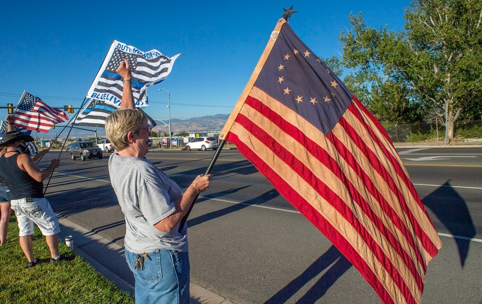 (Rick Egan | The Salt Lake Tribune) Police supporters upset by a Pat Bagley cartoon, protest The Salt Lake Tribune in West Valley City, on Thursday, Sept. 3, 2020.