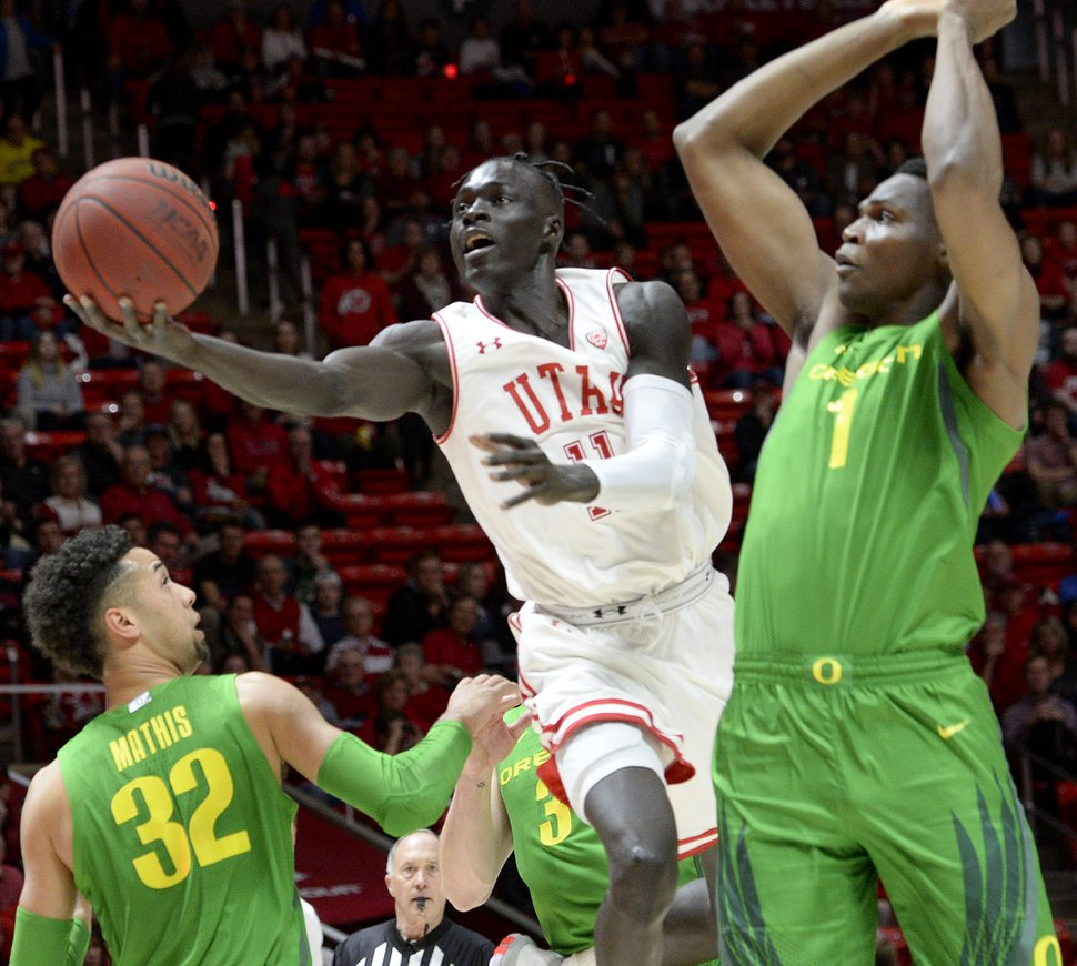 (Leah Hogsten | The Salt Lake Tribune) Utah Utes guard Both Gach (11) drives the court past the Ducks defense as the University of Utah basketball team hosts No. 4 Oregon, Jan. 4, 2020, at the Huntsman Center.
