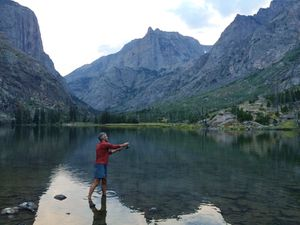 In this Aug. 29, 2016 photo, Mike Eckel tries his hand at trout fishing in Elk Lake, the first of several lakes that drain north along the Beaten Path, a 26-mile hiking trail that crosses through Montana's Absaroka-Beartooth Wilderness. (Ben Yeomans via AP)