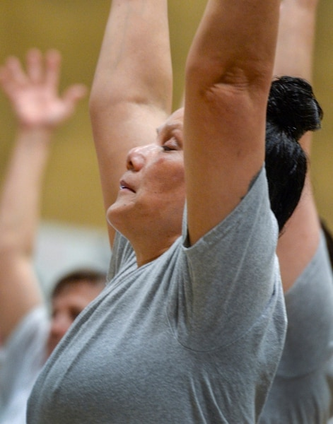 Leah Hogsten | The Salt Lake Tribune Tuusao Ama holds a pose during yoga class at the Timpanogos WomenÕs Correctional Facility gymnasium at the Utah State Prison. Outside volunteers have been teaching yoga at the prison for more than a decade and now inmates can earn their teaching certification.