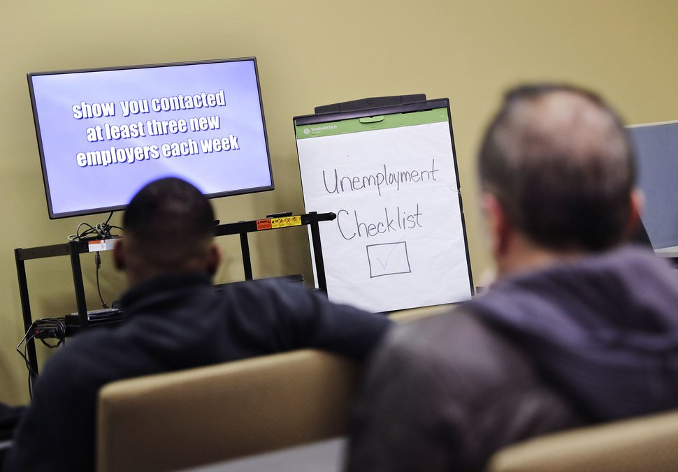 FILE - In this Thursday, March 3, 2016, file photo, people attend an employment orientation class at the Georgia Department of Labor office in Atlanta. On Thursday, March 17, 2016, the Labor Department reports on the number of people who applied for unemployment benefits in the previous week. (AP Photo/David Goldman, File)