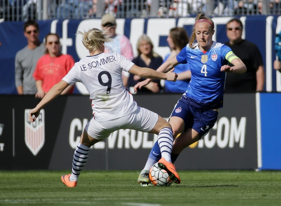 United States' defender Becky Sauerbrunn (4) plays against France's forward Eugenie Le Sommer (9) during the first half of a SheBelieves Cup women's soccer match Sunday, March 6, 2016, in Nashville, Tenn. (AP Photo/Mark Humphrey)