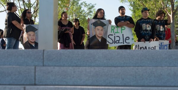 Steve Griffin | The Salt Lake Tribune Family, friends, and supporters of Siale Angilau, who was shot and killed in the Salt Lake City federal courthouse, gather for the Justice4Siale Vigil on the courthouse plaza in Salt Lake City, Utah, Wednesday, June 11, 2014. Glendale community members have organized a coalition called the