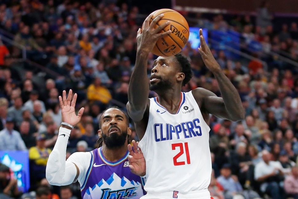 (Rick Bowmer | AP) Los Angeles Clippers guard Patrick Beverley (21) lays the ball up as Utah Jazz guard Mike Conley, rear, defends in the first half of an NBA basketball game Wednesday, Oct. 30, 2019, in Salt Lake City.